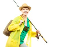 Woman with fishing rod, spinning equipment royalty free stock photo