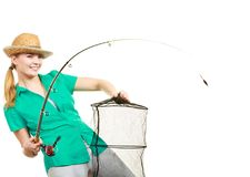 Woman with fishing rod, spinning equipment. Fishery, spinning equipment, angling sport and activity concept. Happy smiling woman with fishing rod and net stock photo
