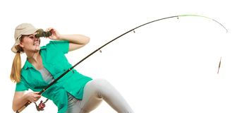 Woman with fishing rod, spinning equipment. Fishery, spinning equipment, angling sport and activity concept. Happy smiling woman with fishing rod royalty free stock images
