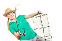 Woman with fishing rod, spinning equipment royalty free stock image
