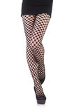 Woman in fishnet stockings Royalty Free Stock Photo