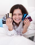 Woman with a fistful of credit cards Royalty Free Stock Images