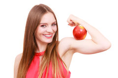 Woman fit girl holds apple fruit on her biceps arm Stock Photos