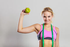 Woman fit girl with measure tape and apple fruit Royalty Free Stock Photo