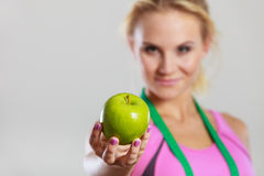 Woman fit girl with measure tape and apple fruit Stock Image