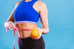 Woman fit girl with measure tape and grapefruit Royalty Free Stock Photo