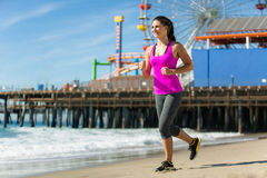 Woman fit healthy happy jogging on beach perfect day space cardio weight loss attractive female Stock Photography