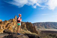 Woman fit hiker enjoy inspiring mountains landscape Royalty Free Stock Images