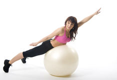Woman with fitball. An attractive middle aged woman in sportswear with a fitball Stock Image