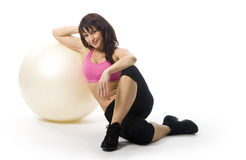 Woman with fitball. An attractive middle aged woman in sportswear with a fitball Royalty Free Stock Photography