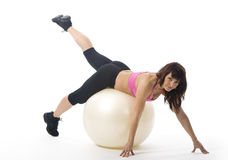 Woman with fitball. An attractive middle aged woman in sportswear with a fitball Royalty Free Stock Images