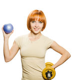 Woman with fitball and dumbbells royalty free stock photography