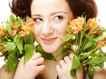 Woman fith bright pink-yellow flowers Stock Images