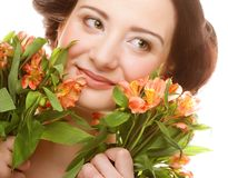 Woman fith bright pink-yellow flowers Royalty Free Stock Photography