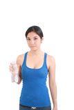 Woman in fitness attire holding water bottle Stock Photo