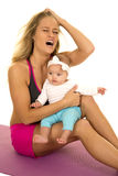 Woman in fitness attire stressd with baby Stock Photography