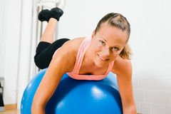 Woman and fitness ball Royalty Free Stock Photos