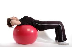 Woman on fitness ball   Royalty Free Stock Image