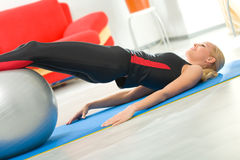 Woman with fitness ball Royalty Free Stock Image