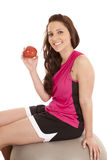Woman on fitness ball with apple Royalty Free Stock Photography