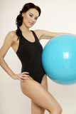 Woman with fitness ball Stock Image