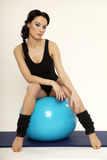 Woman with fitness ball Stock Photography