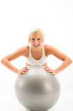 Woman fitness ball exercise on white background Stock Photos