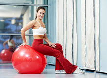 Happy healthy woman with fitness ball Royalty Free Stock Image