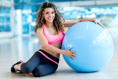 Woman with a fitness ball Royalty Free Stock Images
