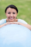 Woman with a fitness ball Stock Photo