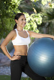 Woman With Fitness Ball In Park Royalty Free Stock Images