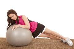 Woman fitness ball side lay sad Royalty Free Stock Photo