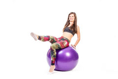 Woman on fitness ball Stock Photos