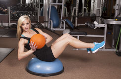 Woman fitness ball twist Royalty Free Stock Photos