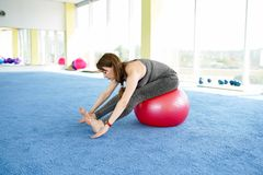 Woman fitness. beautiful Caucasian senior woman with ball in gym . healthy lifestyle royalty free stock images