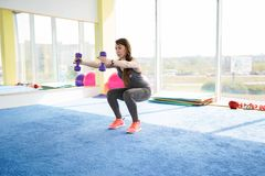 Woman fitness. beautiful Caucasian senior woman doing exercise in gym . healthy lifestyle stock photo