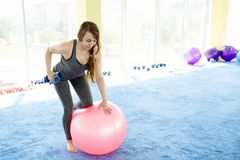 Woman fitness. beautiful Caucasian senior woman doing exercise in gym . healthy lifestyle stock image