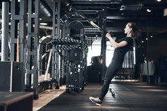 Woman Fitness. Beautiful young woman while training in the gym royalty free stock photography