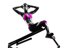 Woman fitness  bench press crunches exercises silhouette Royalty Free Stock Photo