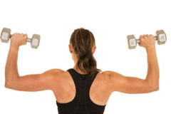 Woman fitness black tank top flex with weights back Stock Photography