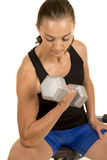Woman fitness black tank top isolation curl look down Stock Photo