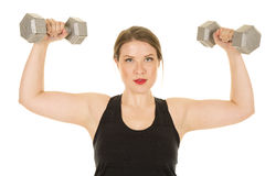 Woman fitness black tank weights up flex serious Royalty Free Stock Images