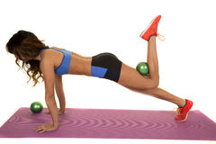 Woman fitness blue bra green ball behind knee push up Royalty Free Stock Images