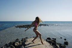 Woman Fitness Body. Fitness Woman in Bikini on Rock Stock Images