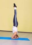 Woman on fitness carpet Royalty Free Stock Photos