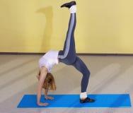 Woman on fitness carpet Stock Image