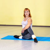 Woman on fitness carpet Stock Image