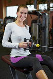Woman in fitness center on cable Stock Image