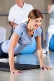 Woman in fitness center doing push Stock Photo