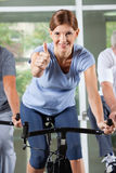 Woman in fitness center holding Royalty Free Stock Photos